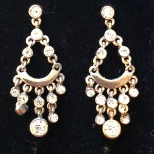 Silver tone dangling earrings with crystals